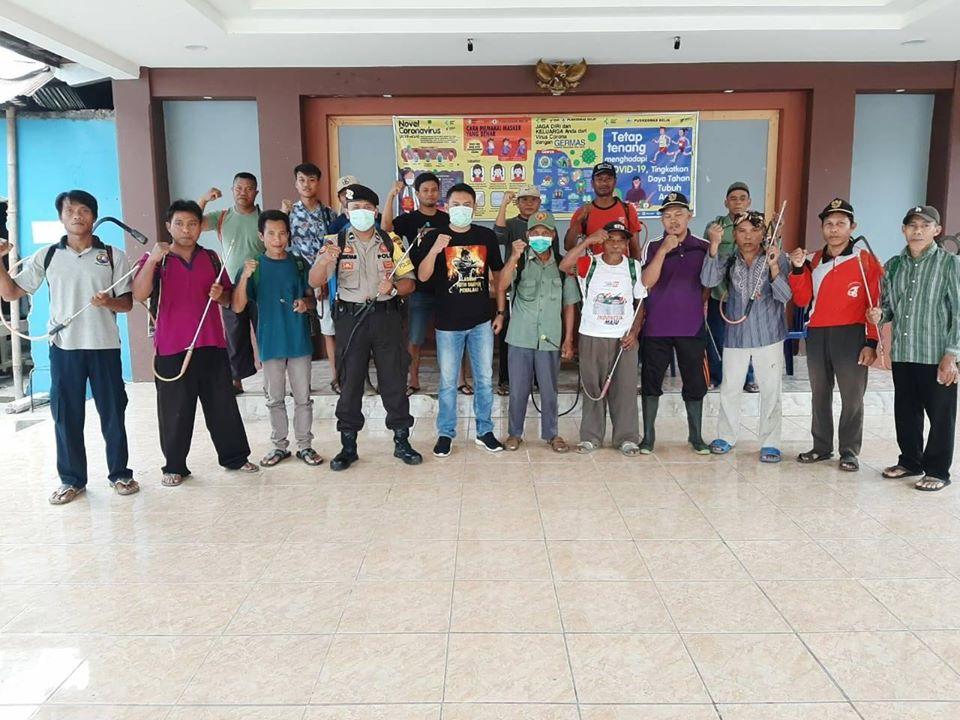 Cegah Penyebaran Covid-19, Pemerintah Desa Lakukan Penyemprotan Desinfektan di Sejumlah Titik